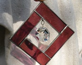 Stained glass suncatcher with crystal and rose colored glass