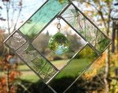 Stained Glass Sunchatcher with Peridot colored crystal hanging in the middle