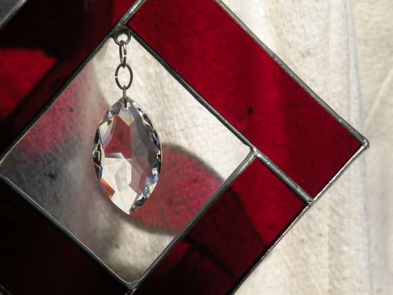 Red stained glass suncatcher with crystal prism hanging inside squared shape