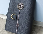 Black leather writing journal - with metla chain and floral design.