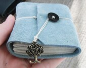 Sky blue mini journal with tree charm. Made from leather suede.