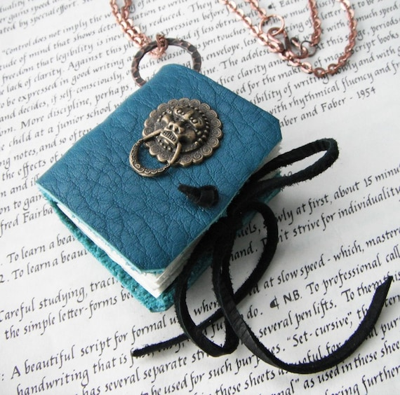 The Lion Knocker - elegant book necklace with copper chain. a locket for your thoughts.