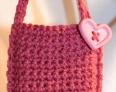 Pink cell phone purse with heart button