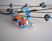 handmade turquoise and tangerine glass flower earrings on sterling silver posts