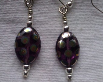 Irridescent purple polka dot dangle earrings