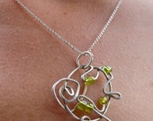 SALE... Abstract Design Sterling Silver Necklace accented with green beads