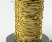 20  yards of gold elastic cord. 1 mm.