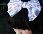 White bow with stripes