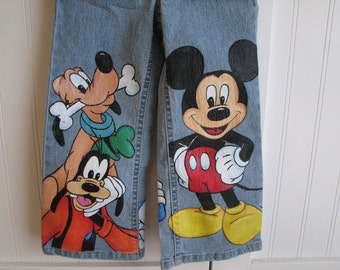 Disney jeans Mickey n Friends with 3  LARGE SIZE CHARACTERS on front  Sz 18m  to 24 m, 2 to size 12 teen