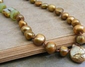 golden simplicity necklace...hand knotted silk golden freshwater pearls with turquoise glass accents and silver toggle clasp
