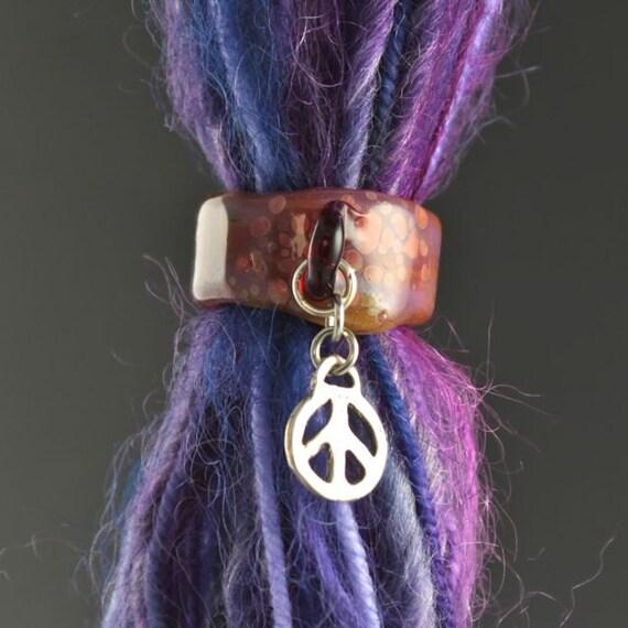 dreadlock bead with a charm