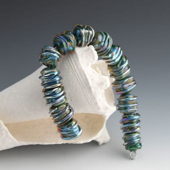 wrapped up blocks of glass beads , metallic wrapped craft beads