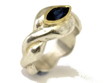A Sapphire  engagement ring - sterling silver , 18k gold.
