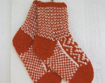 Handknitted norwegian socks in orange and white for children