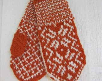 Handknitted norwegian mittens for children in orange and white