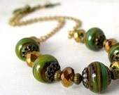 Green Necklace Olive Swirl Lampwork Bead Metallic Brown Faceted Glass with Antiqued Bronze Accents and Toggle Clasp Beaded Jewelry