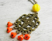Kolbie.  Filigree brass necklace, chandelier finding, cottage chic necklace, tribal style necklace, long layering necklace.