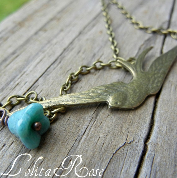 Amelia. Brass swallow necklace, sparrow bird necklace, blue flower, turquoise glass flower necklace.