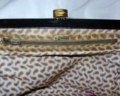 Letisse 70s black leather  bag with cotton lined paisley print