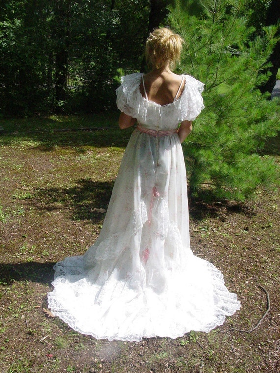Country rose long maxi gown of the 1970s. Prairie style with lace and long train. Off the shoulder romance