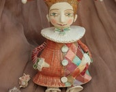 Ceramic Harlequin. Doll, bell and sculpture.