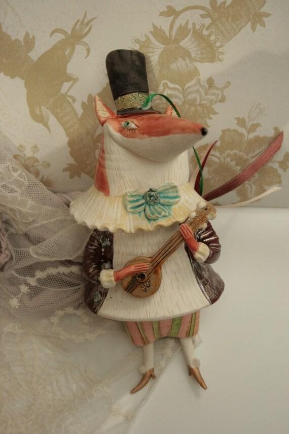 Fox with a mandoline, ceramic bell doll