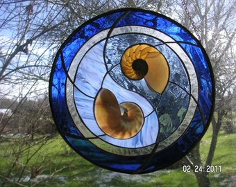 Round sliced double nautilus seashell window in blue