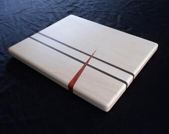 Maple and Peruvian Walnut w/Padouk Spike Cutting Board