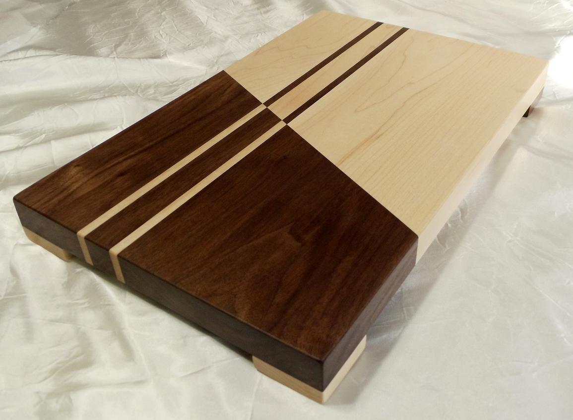Contrasting maple and walnut wood cutting board w feet