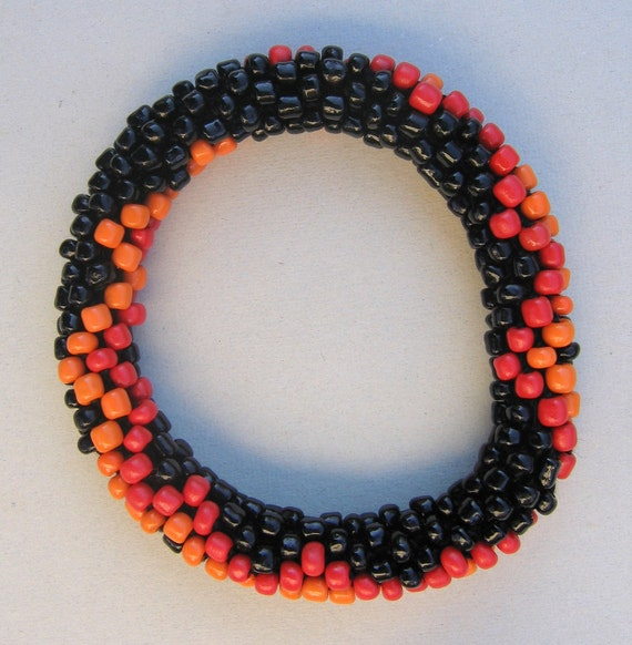 Crocheted Black, Orange, and Red Glass Bead Bangle Bracelet.  Made in Michigan