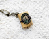 SALE Number 30 - A Book Necklace - Handmade Miniature Ochre Leather Journal with Tea Stained Pages