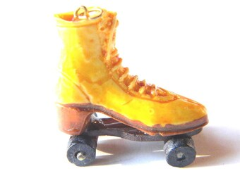 Vintage Yellow Brown Plastic Shoe Roller Skate Charm Pendant Figural