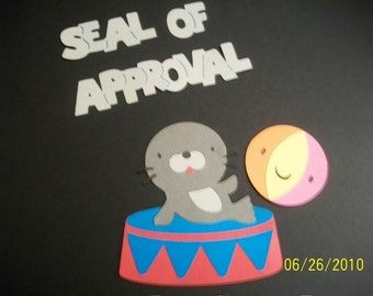 seal on stand, beach ball and seal of approval title diecut