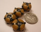 Tan with Black Lampwork Beads