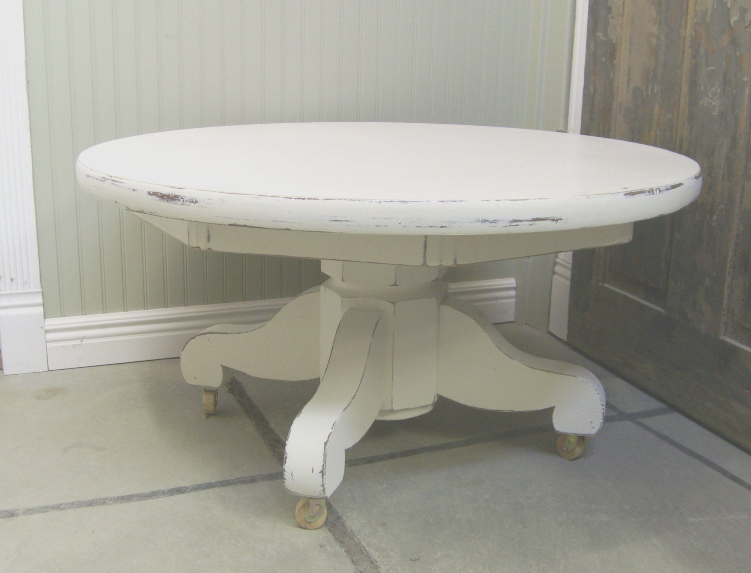 Vintage distressed white pedestal coffee table for Distressed white round coffee table