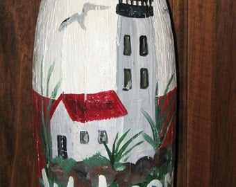 Lighthouse painted Welcome buoy