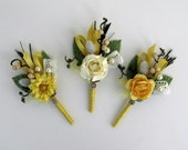 Happy - A mix of coordinating yellow boutonniere.
