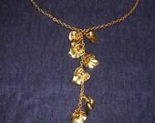 SALE ITEM.  Brass flowers on brass Y chain