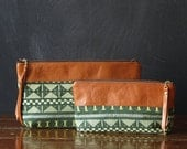 the 12-inch OVERSIZED zipper pouch. tapestry and eco leather.