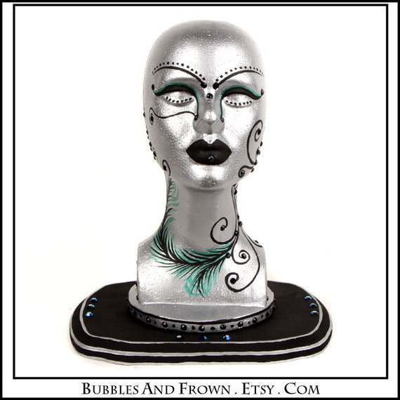 Silver and Teal Peacock ... Mannequin Head in Silver with Black and Teal Accents