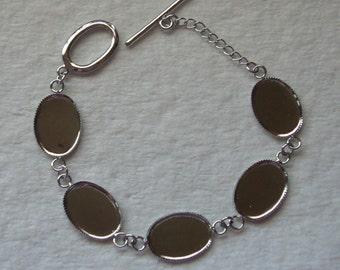 6 Silver tone bezel bracelets with five 18 x 13 settings