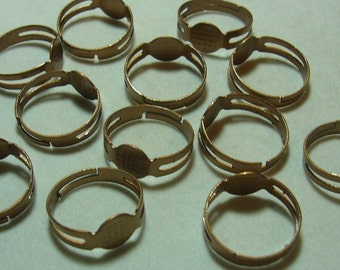 12 bronze tone ring blank finding with glue on pad