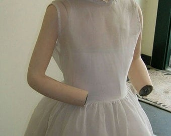 1950's Girl's white organdy dress, with wide eyelet edging at bottom of dress