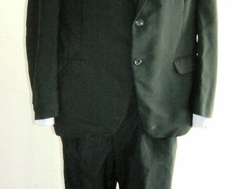 "1960's 42"" chest, 32"" waist ""men in black"" light weight worsted wool black suit."