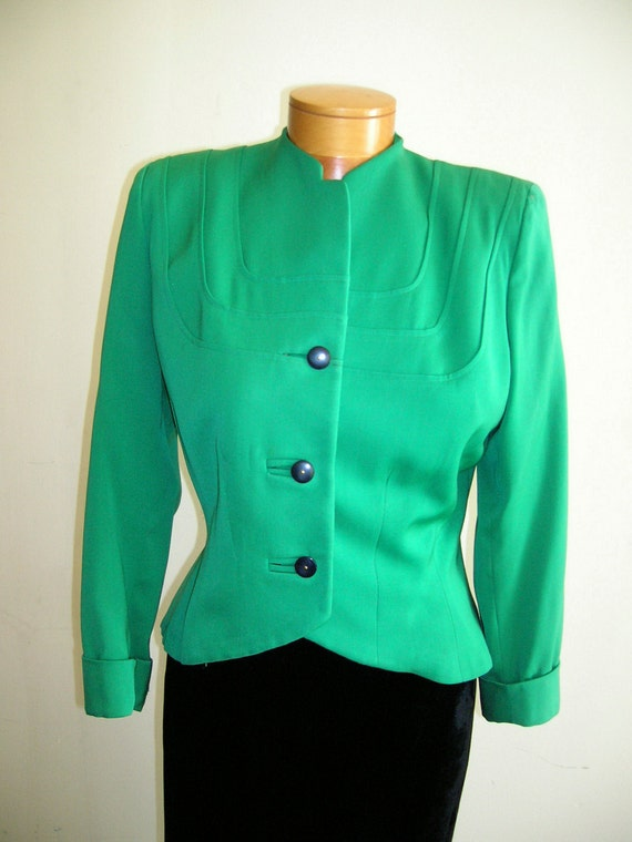 1940's Small green gabardine short jacket, with padded square shoulders.