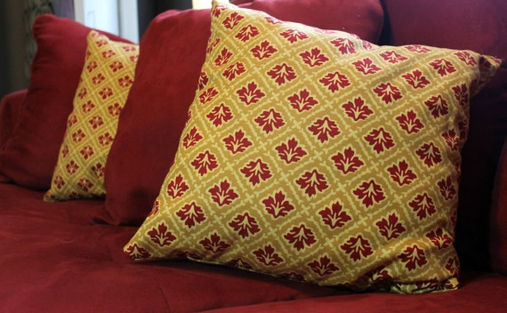yellow and red brocade throw pillow