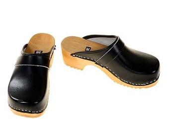 Clogs black / bright sole