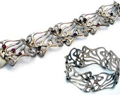 Israeli jewelry   elegant and modern sterling silver and garnets bracelet