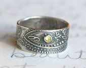 wide paisley wedding band with fair trade yellow sapphire . wide recycled silver wedding band . bohemian paisley ring . enjoy the journey