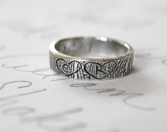 rustic bark wedding ring with carved initials in hearts . simple personalized womens mens recycled silver wedding band . secret message ring